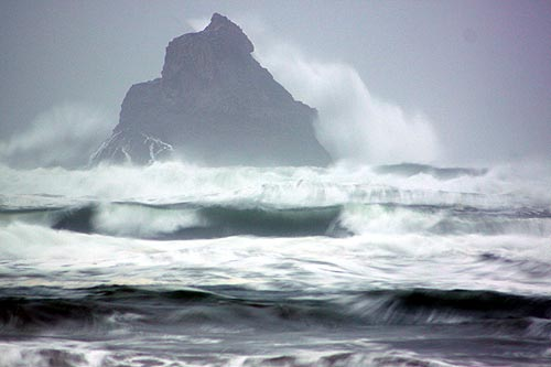 Photo: mammoth waves hit rocks off Arch Cape